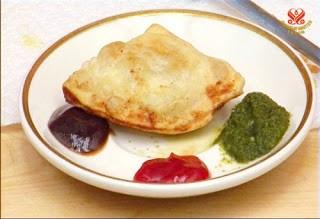 Món chay : Bánh gối Ấn Độ giòn và thơm ngon .